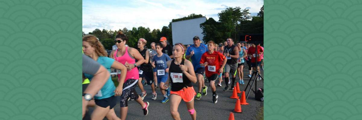 Vac & Dash Moonlight 5K - Ten-Miler - Double Feature Half-Marathon & Movie Banner Image