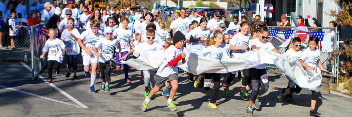 Raymond Knowles School Veteran's Day Run Banner Image
